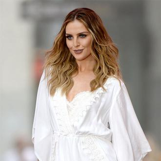 Perrie Edwards tells fans to stay positive during 'weird time'