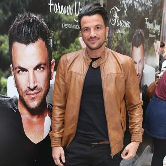 Peter Andre feels too 'shy' to take off his top