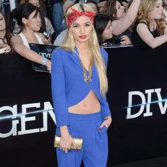 Pia Mia wears crop tops to 'elongate' her body
