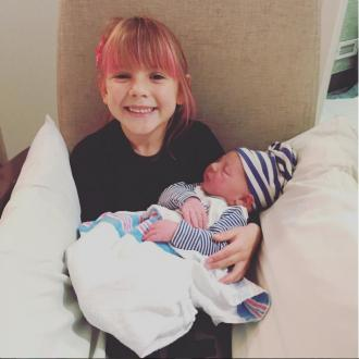Pink shares photo of two children bonding