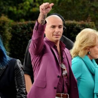 Pitbull inspired John Travolta's new look