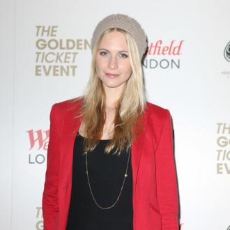 Poppy Delevingne envies Cara's bushy brows