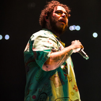 Post Malone gifts every kid at his former school a pair of his custom Crocs