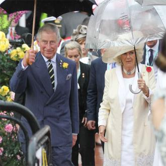 Prince Charles And Camilla Visit Prince Of Cambridge