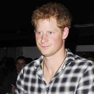 Prince Harry flirts with Ashley Roberts
