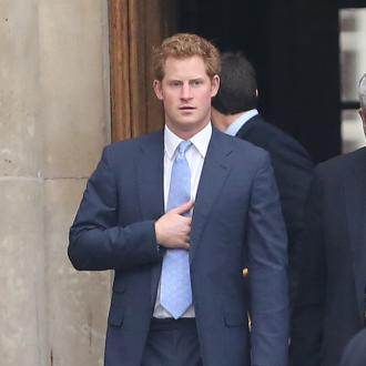 Prince Harry cosies up to Cara Delevingne