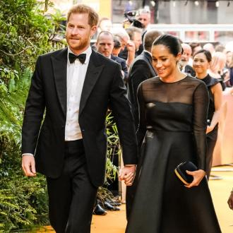 Prince Harry and Duchess Meghan arrive in South Africa