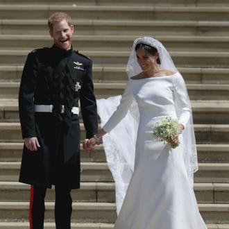 Duchess Meghan wanted wedding dress to 'represent' change