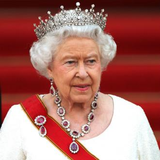 Queen Elizabeth II has urged people to 'never give up'
