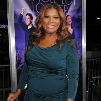 Queen Latifah Thrilled To Swim With Sharks