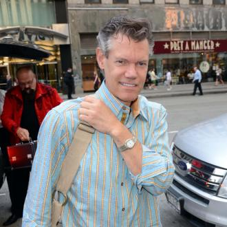 Randy Travis 'awake and alert'