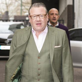Ray Winstone uses sunbeds