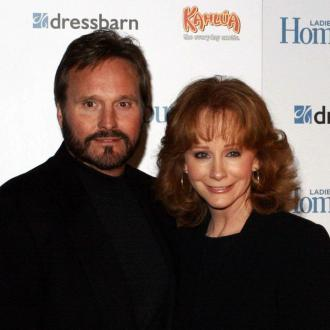 Reba McEntire puts faith in god post-split