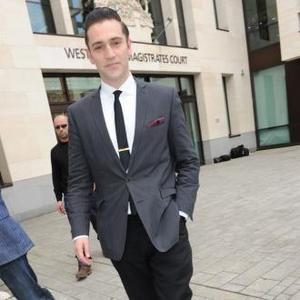 Reg Traviss Denies Rape Charge