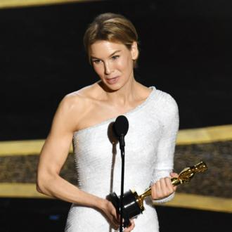 Renee Zellweger celebrates heroes at Oscars