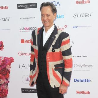 Richard E Grant hit with metal bar