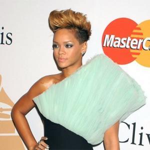 Rihanna Treats Tipsy Entourage