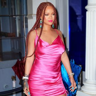 Rihanna warns fans to quit asking about new music