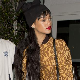 Rihanna Contemplates Drake Tattoo