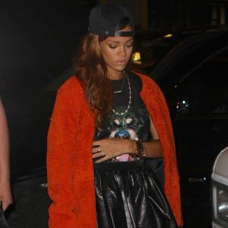 Rihanna parties with NFL stars