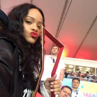 Rihanna Flashes Bra For Germany