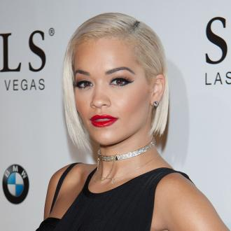 Rita Ora 'desperately trying to make friends' with Calvin Harris