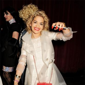 Rita Ora performs birthday lap dance