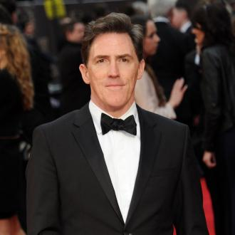 Rob Brydon took swimming lessons from a neighbour