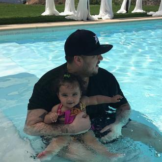 Rob Kardashian Goes Swimming With Dream