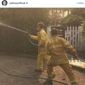 Rob Lowe helps firefighters hose down Santa Barbara home