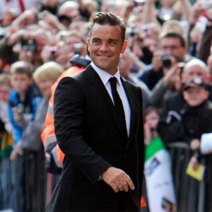 Robbie Williams Working Out Baby Deal