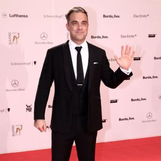 Robbie Williams pays tribute to long-time manager