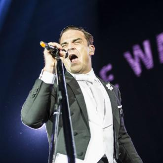 Robbie Williams Claims 12th UK Solo Number One