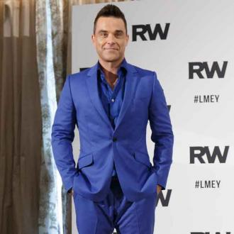 Robbie Williams taking kids on tour