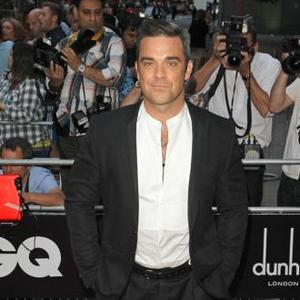 Robbie Williams Gets Pregnancy Pains