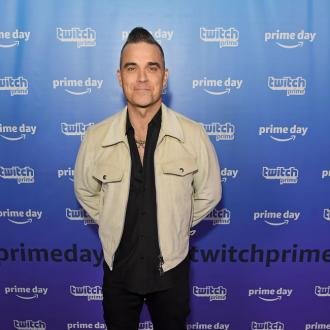 Robbie Williams' daughter is writing songs