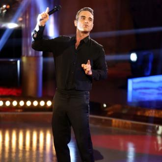 Robbie Williams gets first mobile phone in 14 years