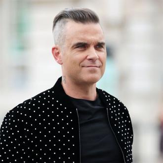 Robbie Williams trod on Mark Owen's head on stage