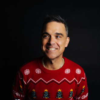 Robbie Williams makes light of pandemic on new pun-filled Xmas song