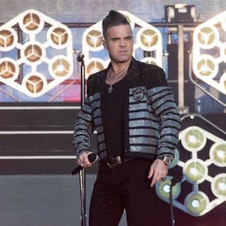 Robbie Williams' stage persona is not the real Robbie
