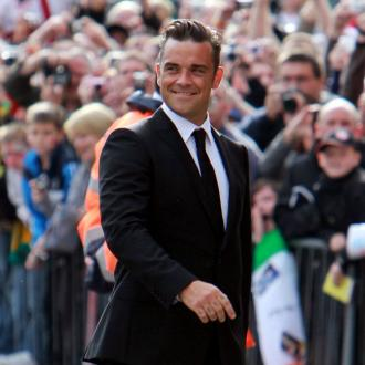 Robbie Williams On Best Behaviour For Daughter