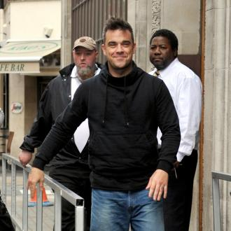 Robbie Williams Is Too Muscular For Clothes