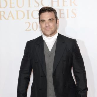 Robbie Williams Is A 'Natural' Father