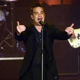 Robbie Williams To Release New Swing Album