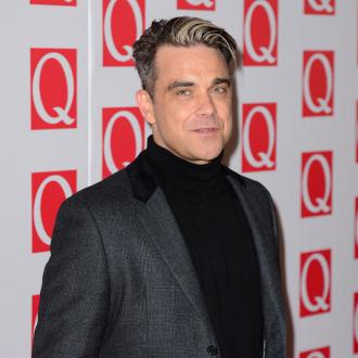Robbie Williams Enjoys Competing With Gary Barlow
