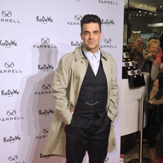 Robbie Williams Getting Tattoo For Son