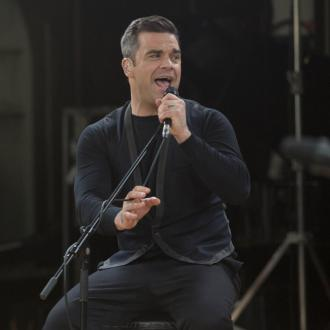 Robbie Williams Used Concert Film To Impress Girl