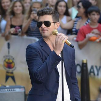 Robin Thicke 'a rock' for his grieving family
