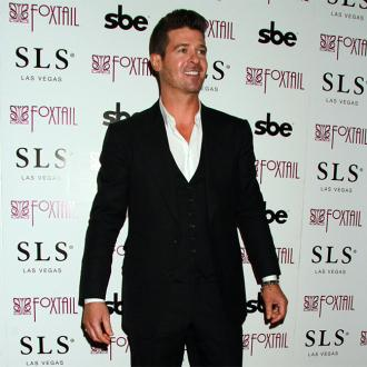 Robin Thicke took up music to impress a crush