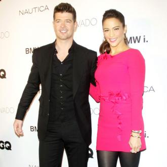 Robin Thicke and Paula Patton getting along better
